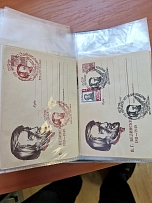 Three folders tightly packed with envelopes with special cancellation marks (1 -