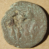 Roman coin possibly from Judea with figures on either side & 1 or 2 countermarks
